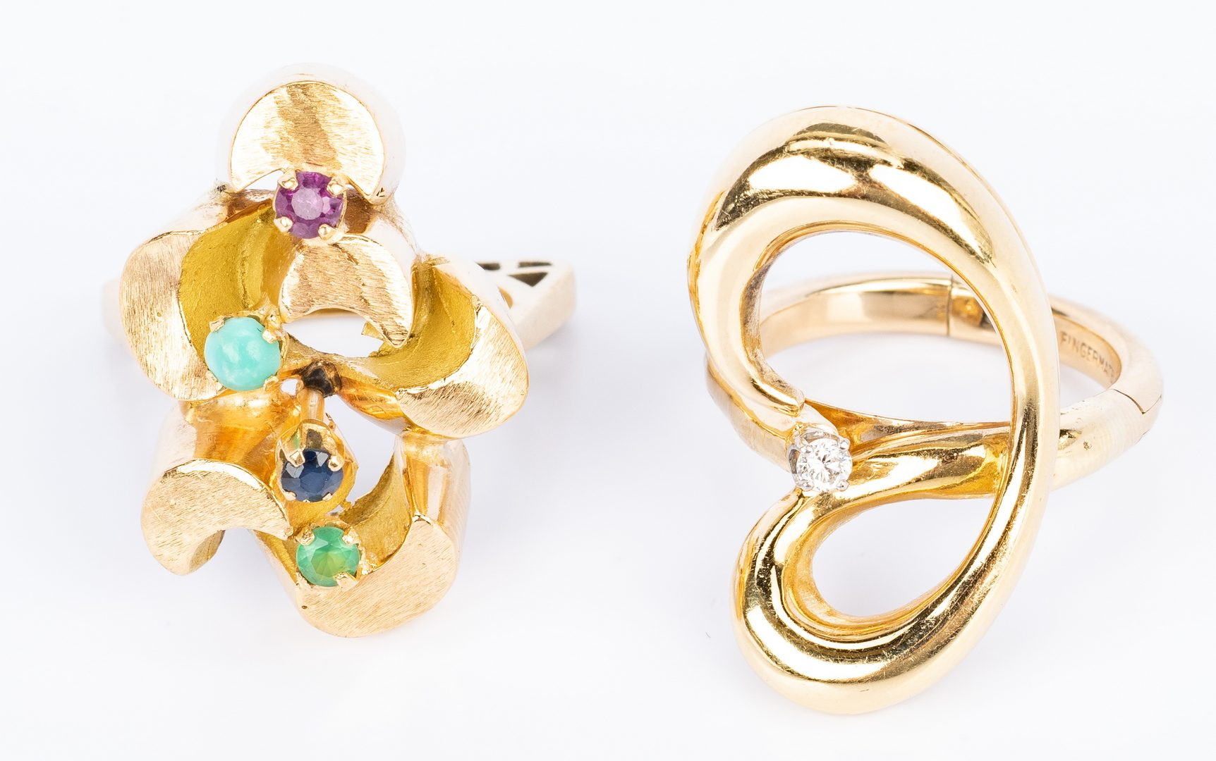 Lot 828: 2 Gold Fashion Rings, 18K and 14K
