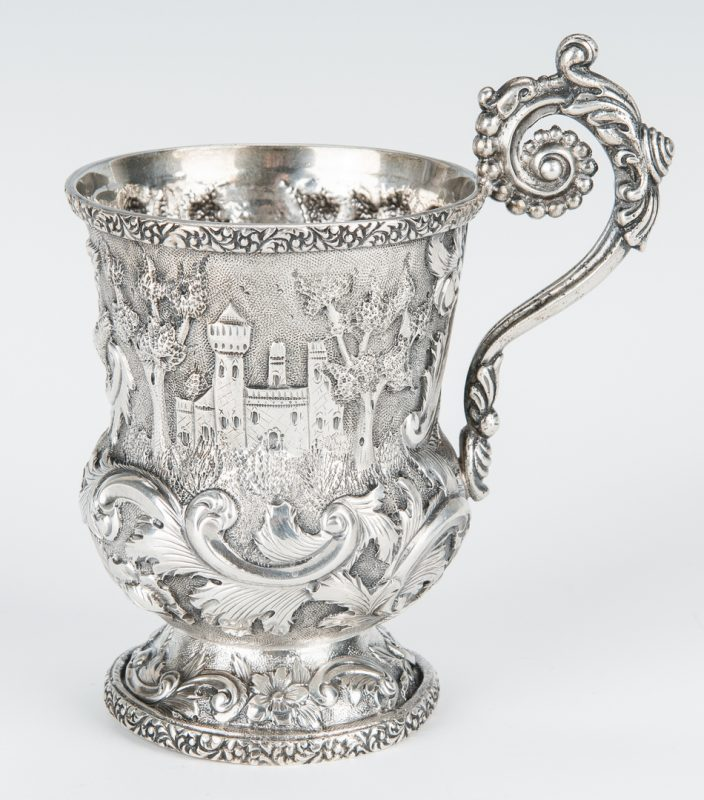 Lot 843: Sterling Repousse Castle Pattern Child's Mug