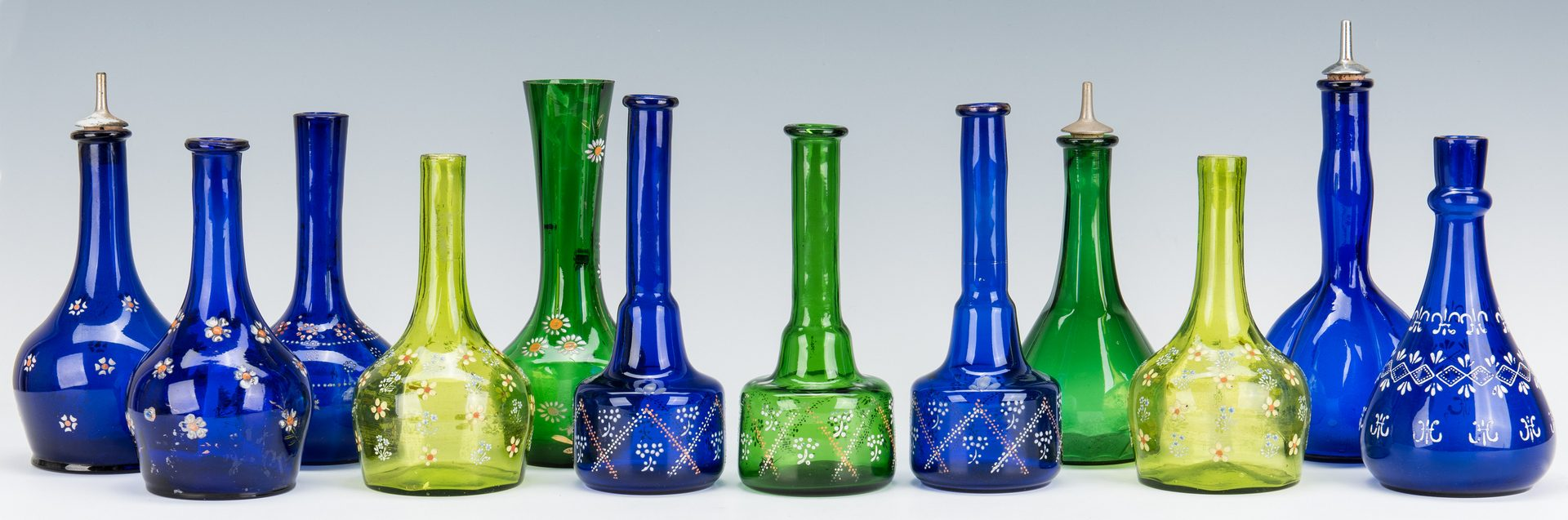 Lot 131: 11 Cobalt & Green Glass Barber Bottles & 1 more
