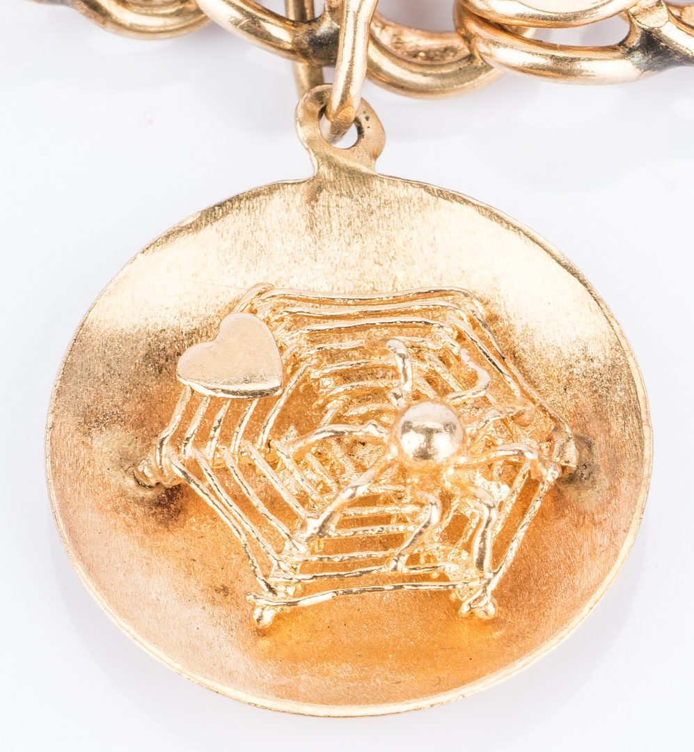 Lot 16: 14k Charm Bracelet, 8 Charms