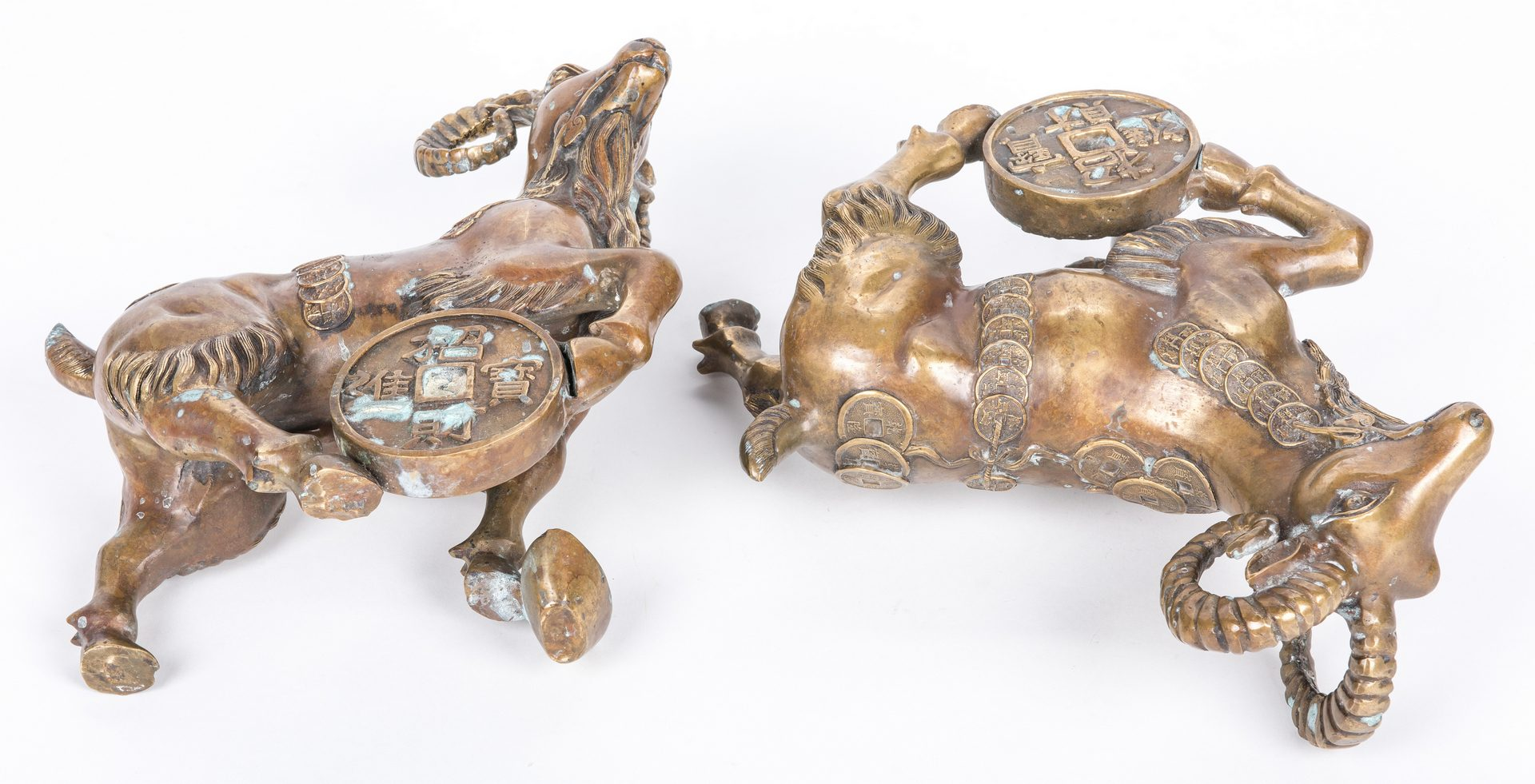 Lot 402: Pair Chinese Ram figures, Ming style