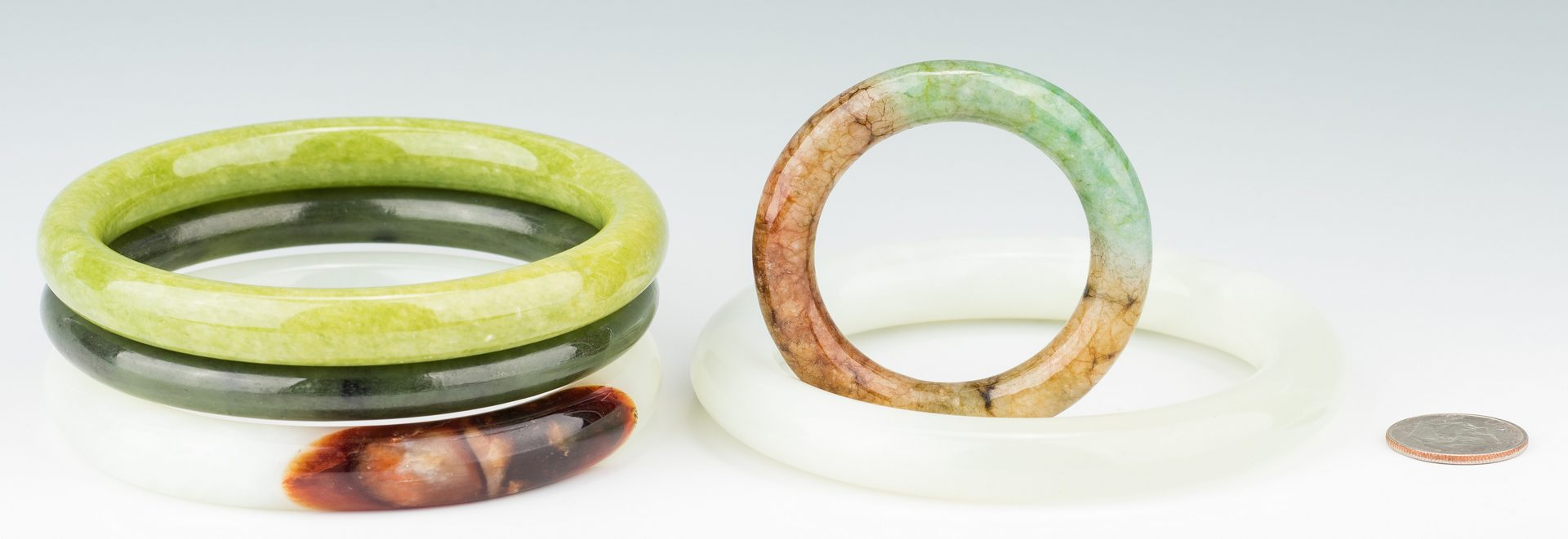 Lot 408: 5 Chinese Carved Jade Bangles