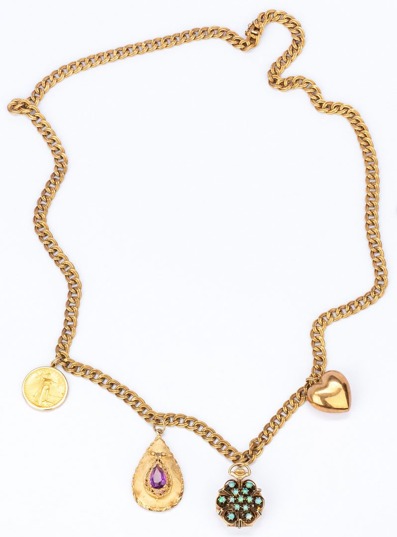 Lot 178: 14K gold chain with 4 charms incl. coin