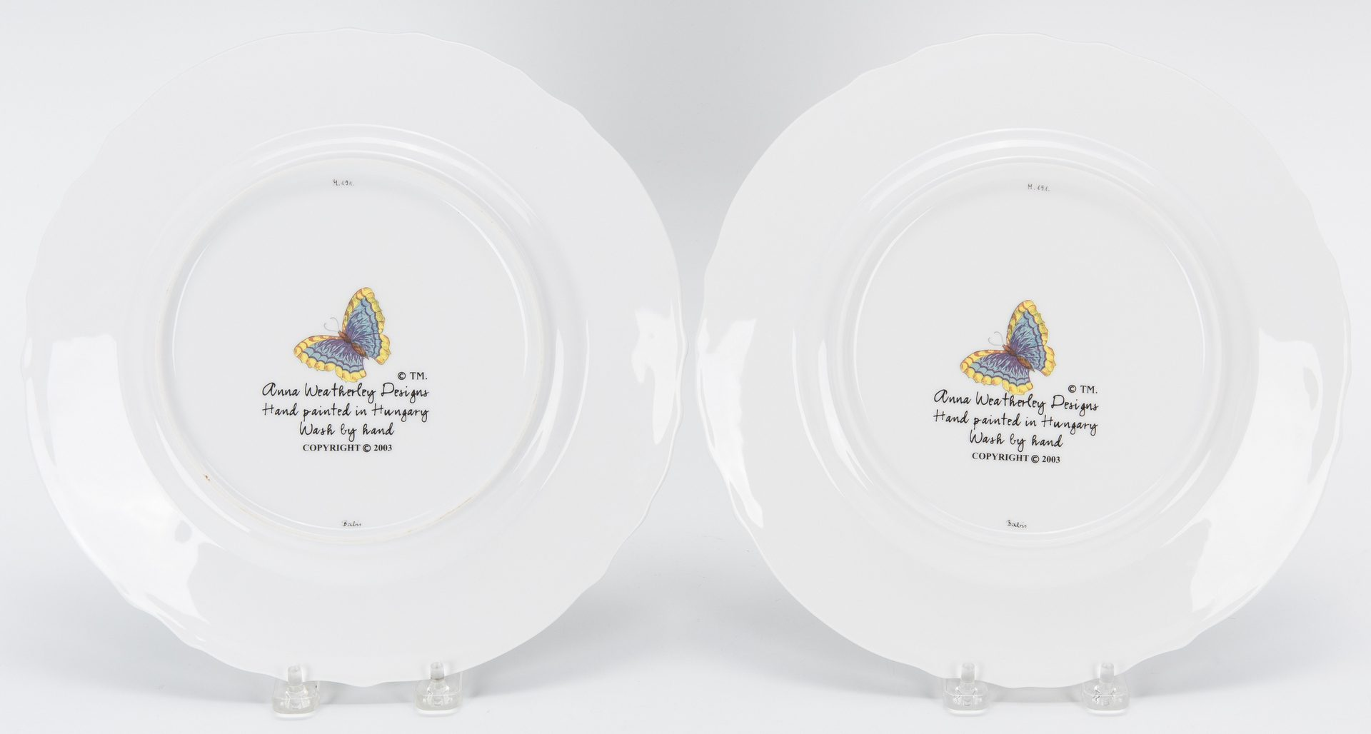 Lot 258: 8 Anna Weatherley Porcelain Dinner Plates