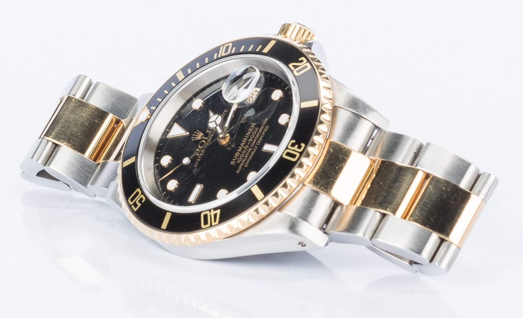Lot 50: Gents Rolex 18k/Steel Submariner Black face