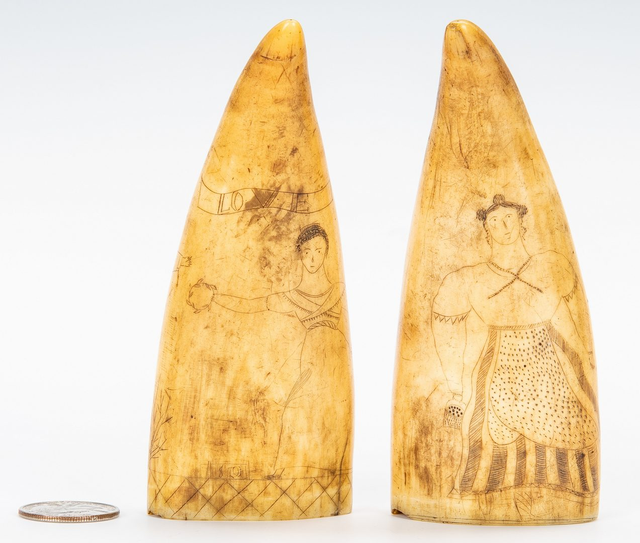 Lot 603: 19th c. Pair Scrimshaw Folk Art Carvings