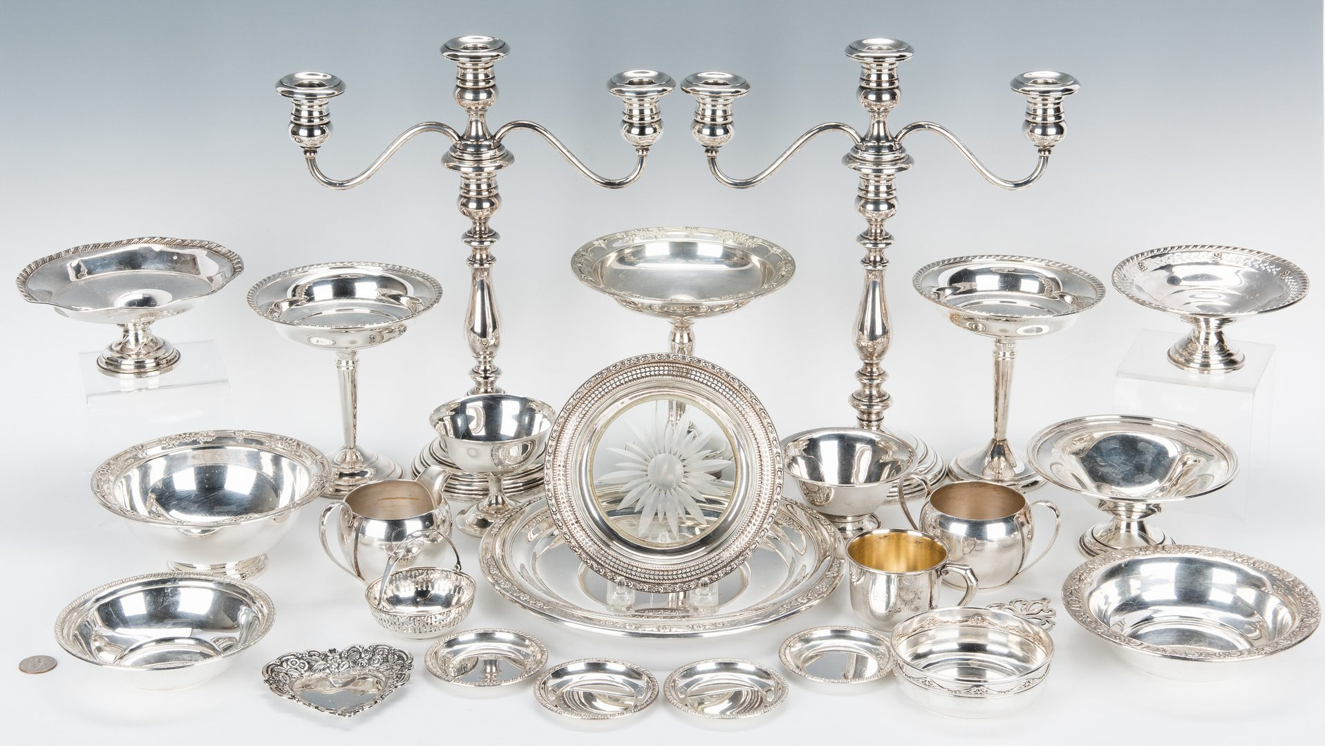 Lot 656: 25 pcs. Sterling Holloware incl. Candlesticks, Candy Dishes