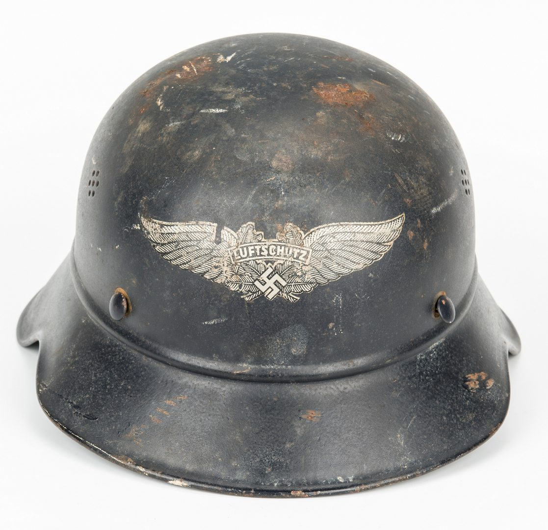 Lot 725: WWII German Helmet & WWI Booklet, 2 items