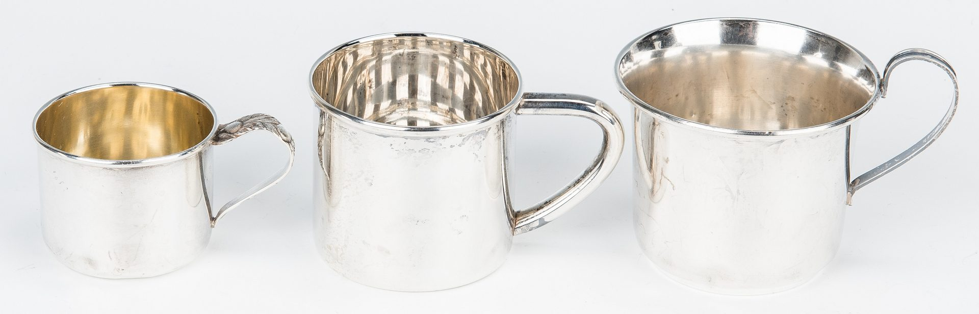 Lot 769: 10 Sterling Table Items inc. plates, cups