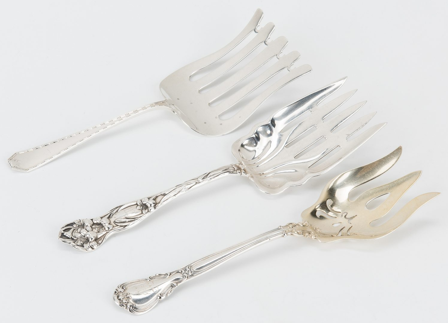 Lot 770: 7 Sterling Serving Forks incl. Asparagus