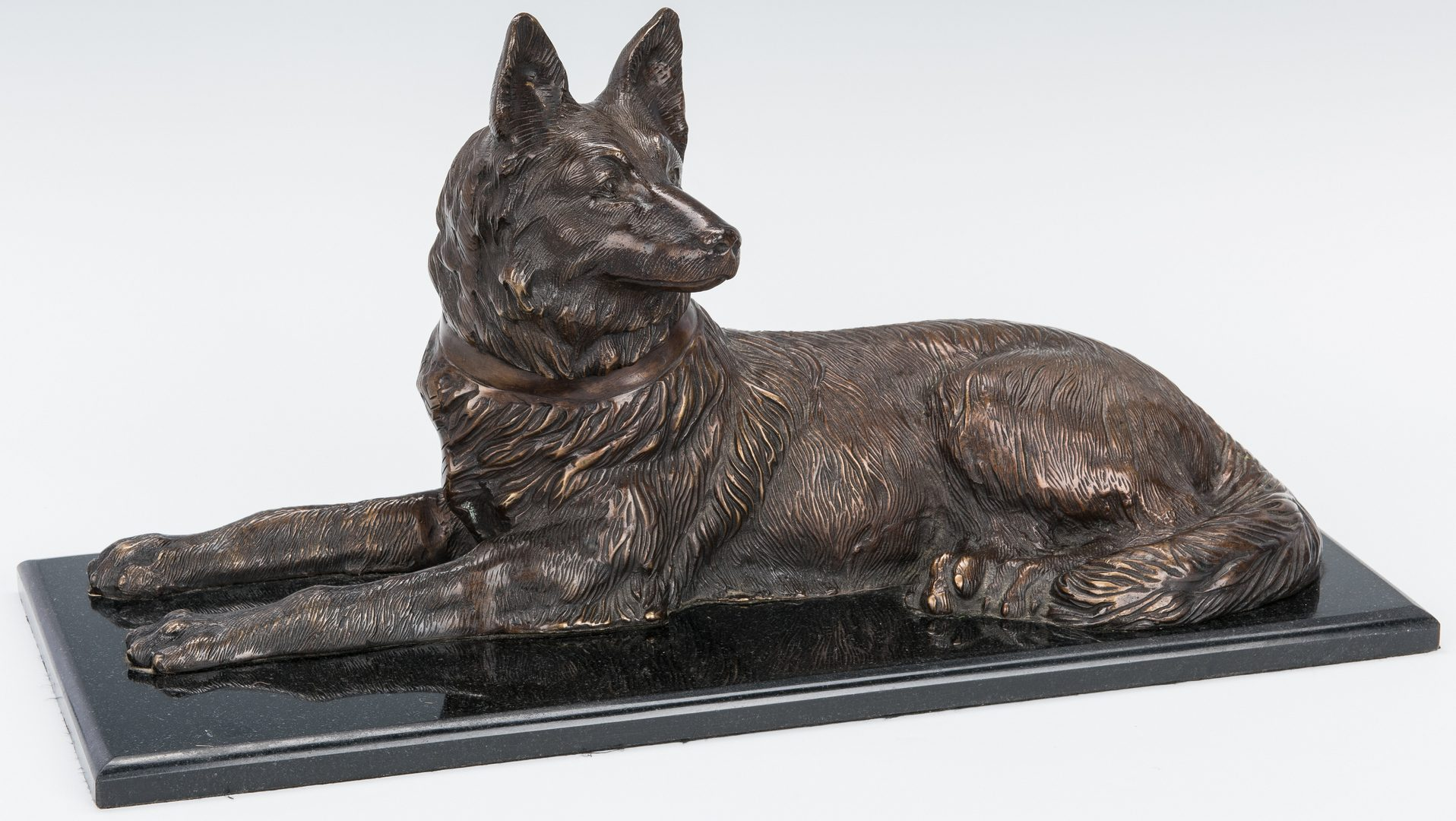 Lot 151: Large Bronze Sculpture of Recumbent Dog after Chiparus