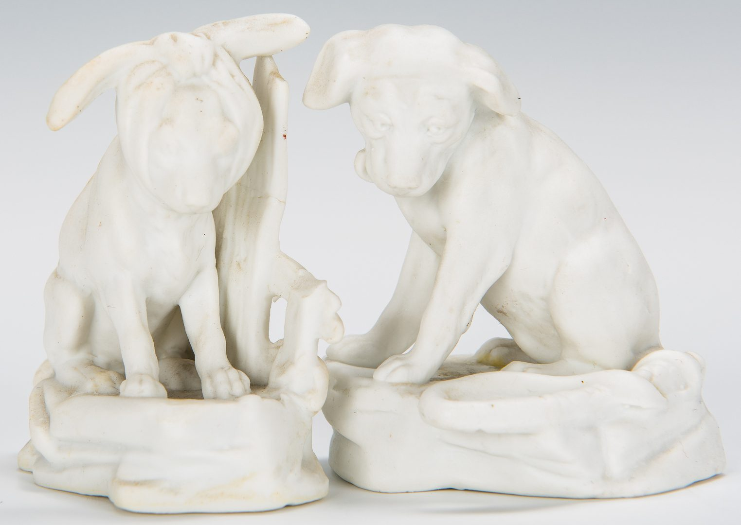 Lot 174: Group of 6 Parian Ware Dog Figures