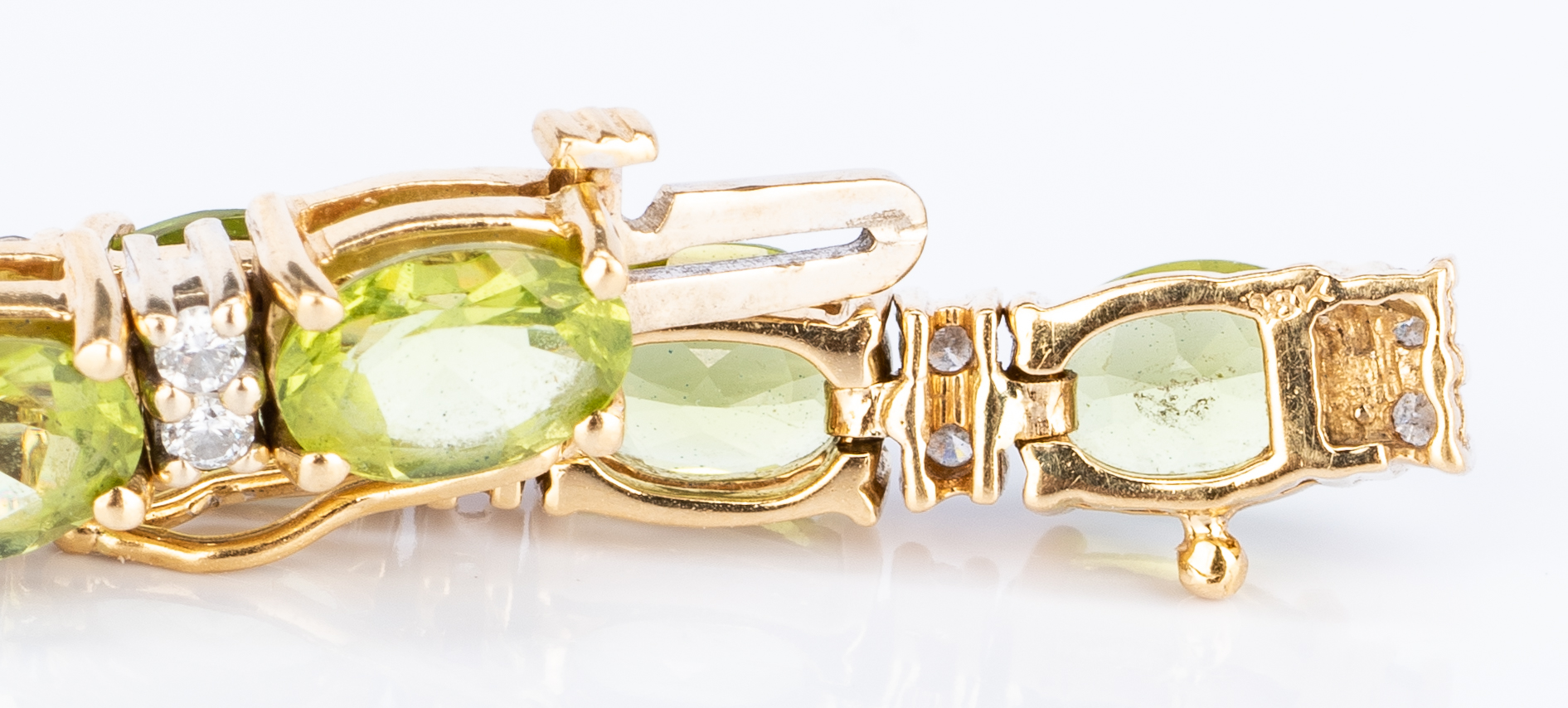 Lot 35: 18k and 14k Diamond & Peridot Set