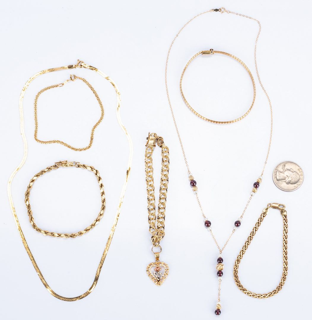 Lot 38: Group seven 14k Gold Jewelry Items