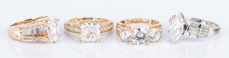 Lot 52: 4 14K Faux Diamond Travel Rings