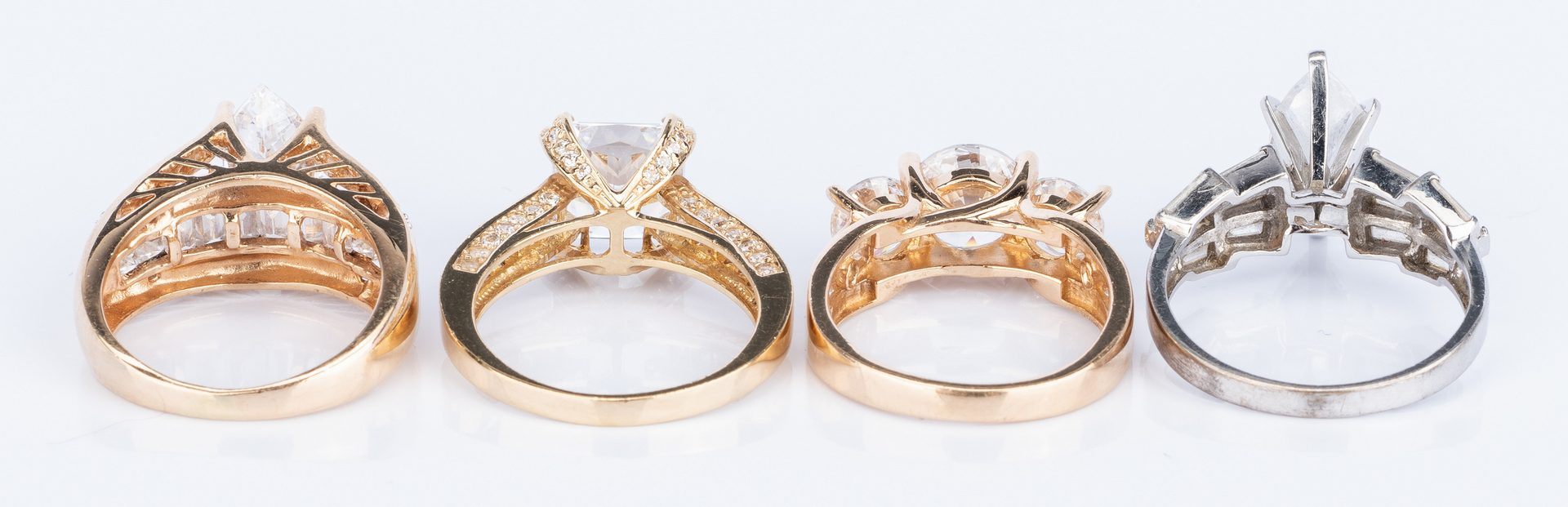 Lot 52: 4 14K Faux Diamond Travel Rings