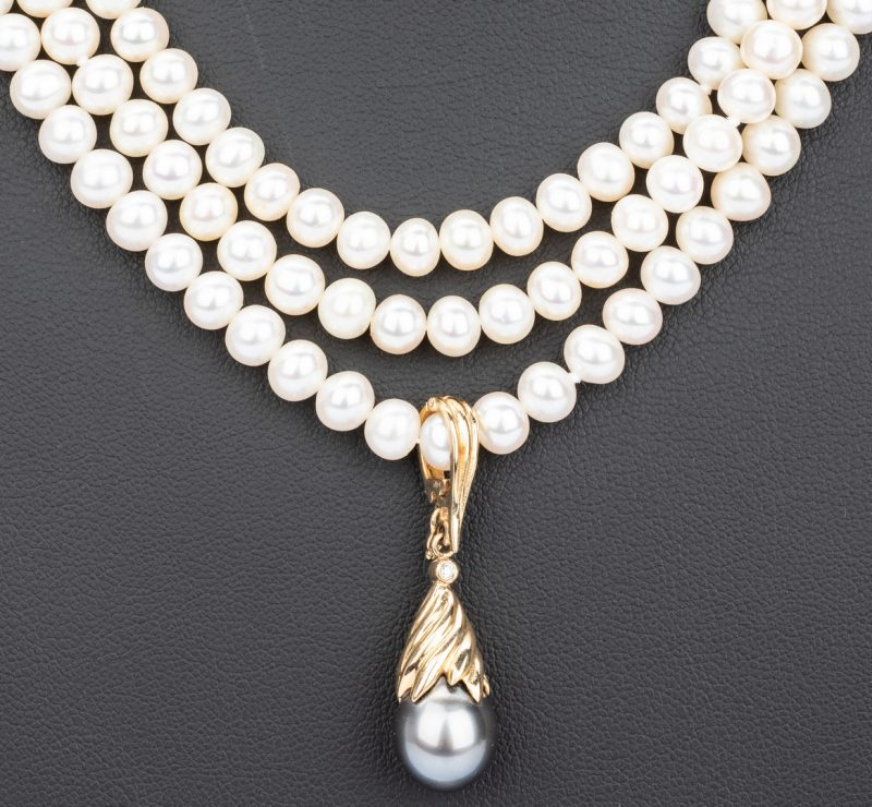 Lot 55: Three Strand Pearl Necklace and Enhancer