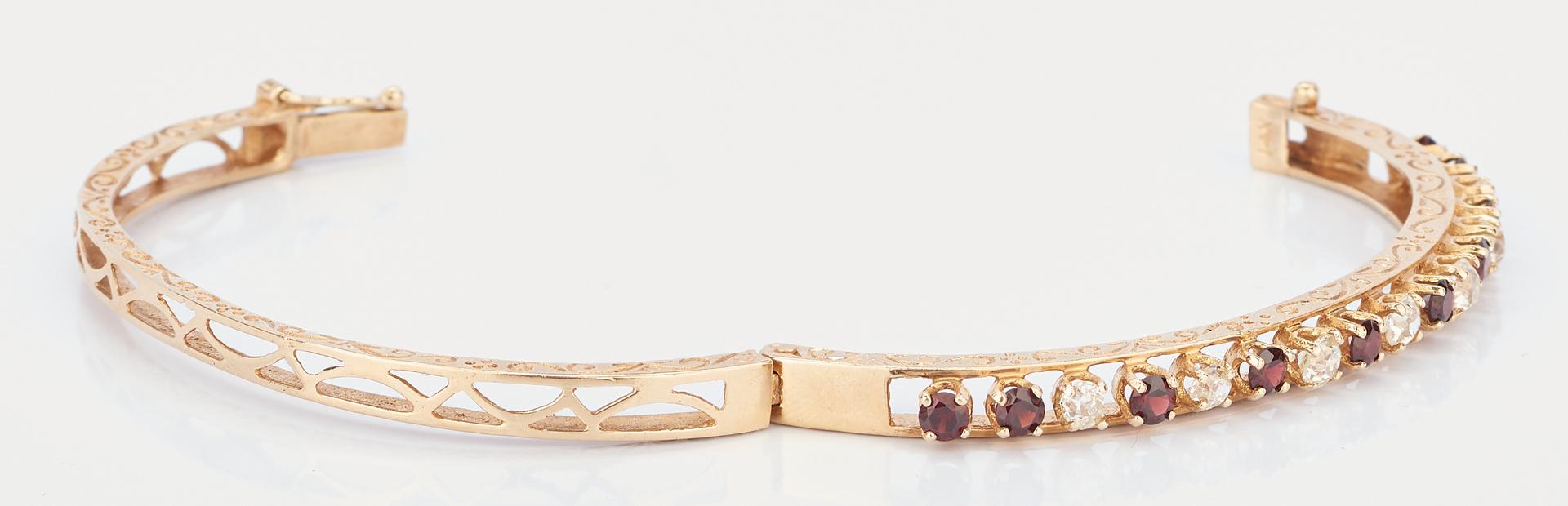 Lot 1022: 14K Diamond and Garnet Bangle Bracelet