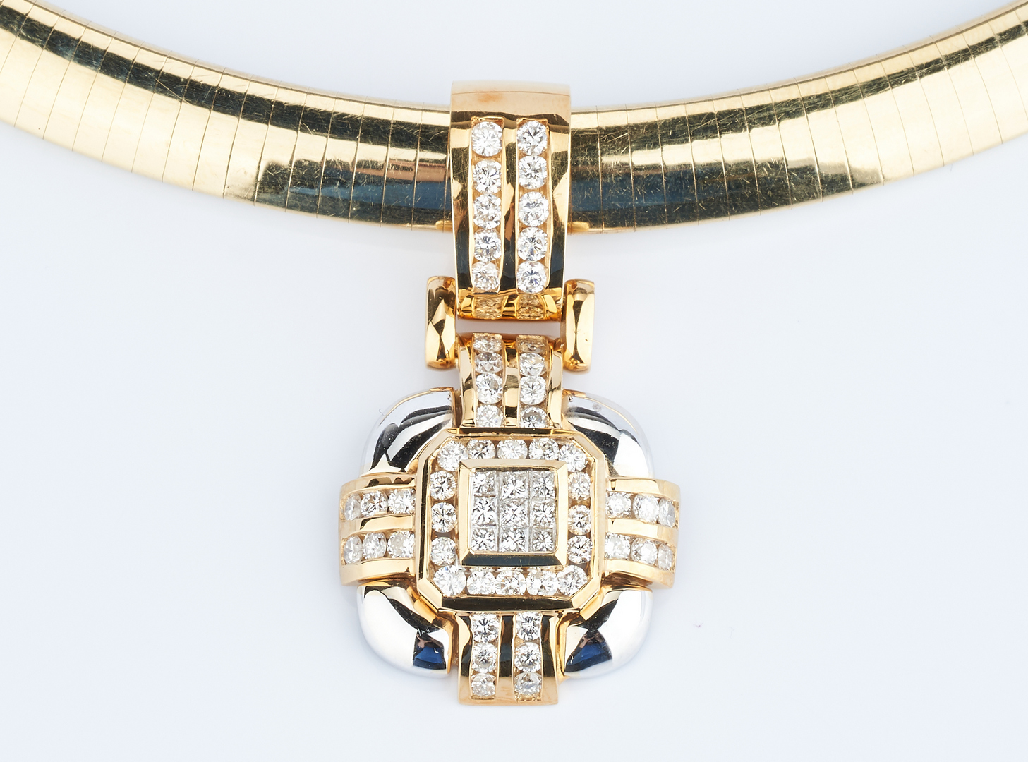 Lot 211: 14K Omega Choker Necklace w/ 18K Diamond Pendant