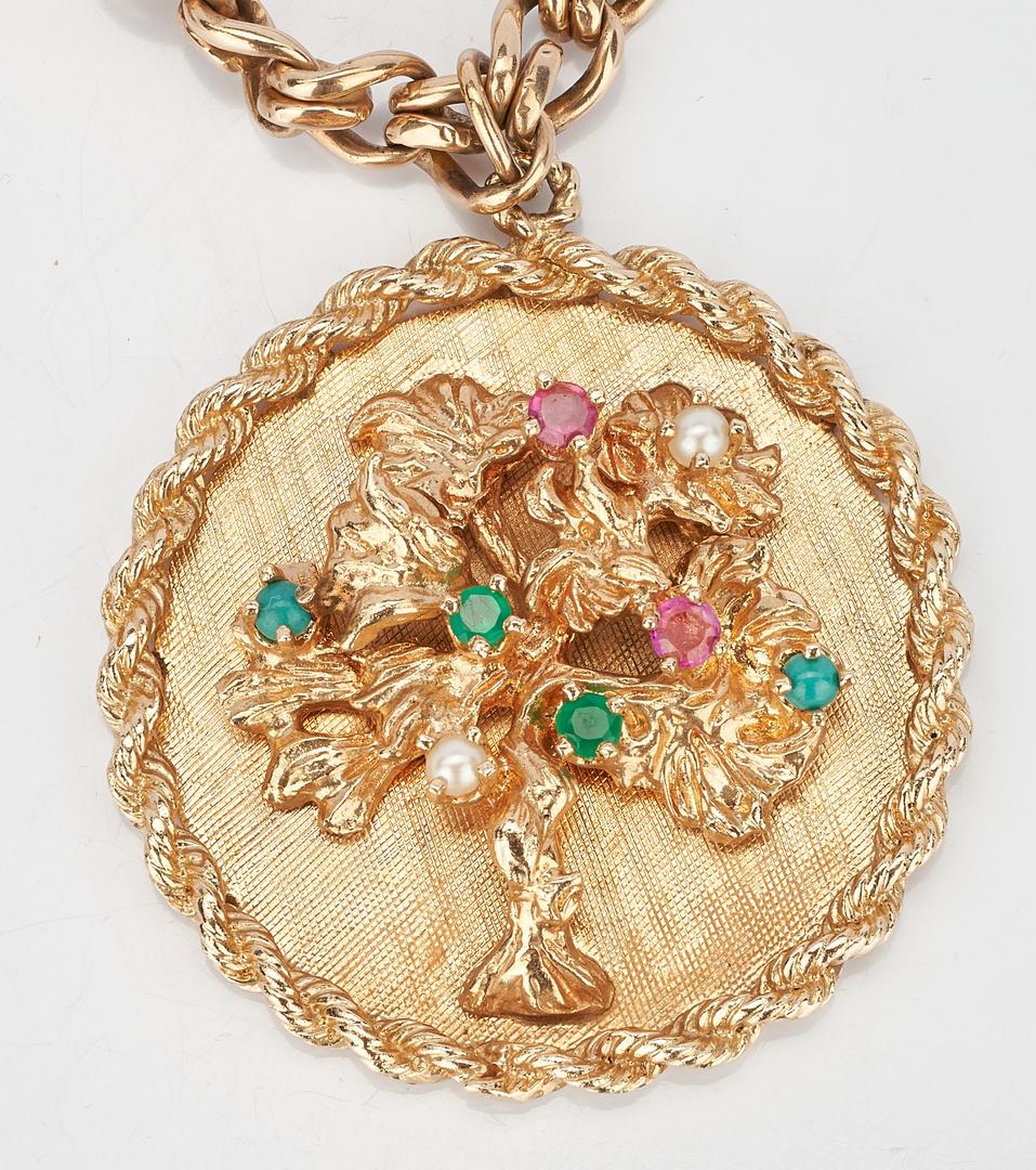 Lot 220: 14K Charm Bracelet, 5 charms