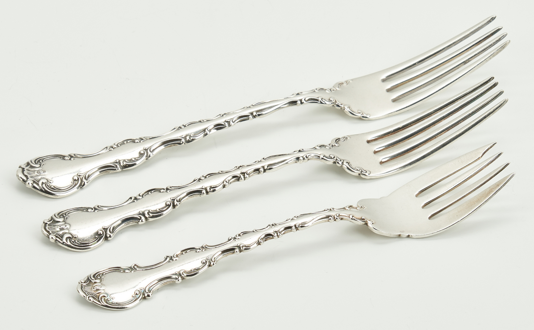 Lot 240: 100 pcs. Gorham Strasbourg and Whiting Louis XV Sterling Flatware