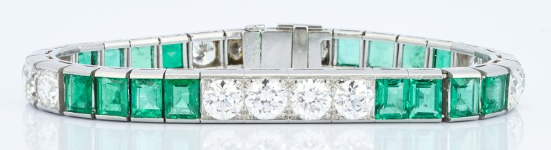 Lot 31: Ladies Platinum Diamond and Emerald Bracelet
