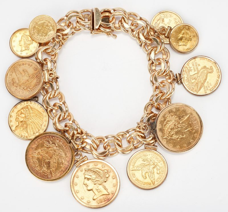 Lot 35: 14K Gold Charm Bracelet, 86.2 grams
