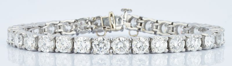 Lot 38: Platinum Diamond Tennis Bracelet, 13 CTW