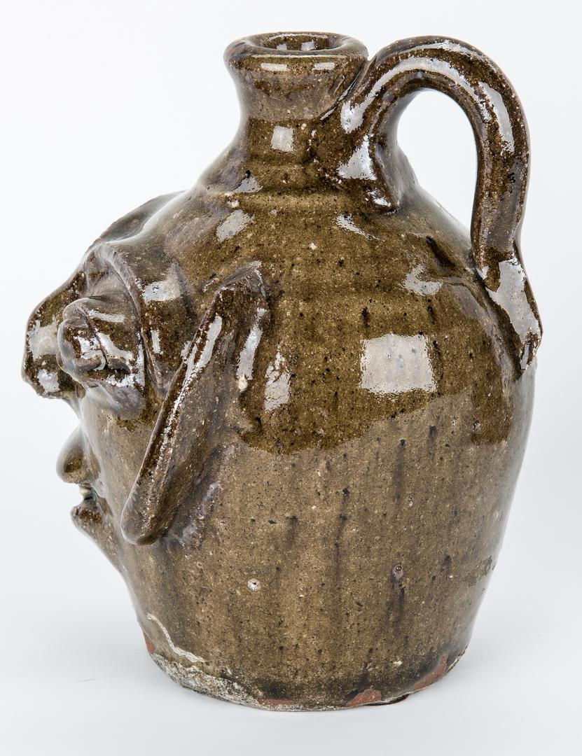 Lot 397: 2 NC Burlon Craig Folk Pottery Items, Face Jug & Bird House