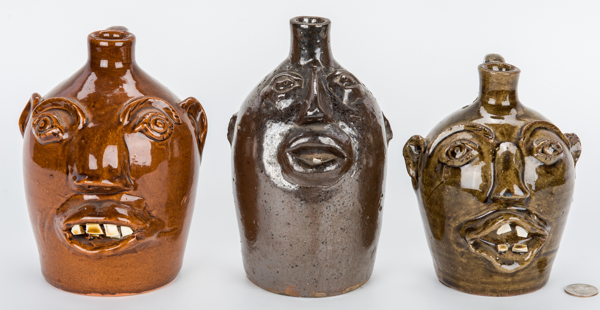 Lot 398: 3 Brown's Pottery, NC Face Jugs, incl. Early Face Jug