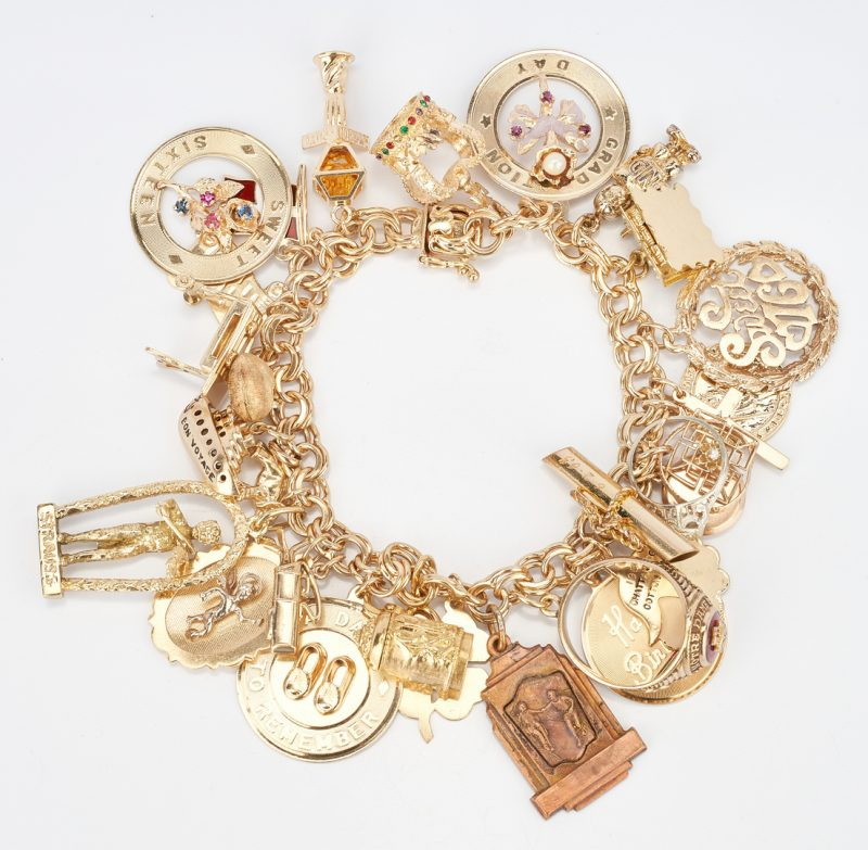 Lot 42: 14K Charm Bracelet with 30 Charms