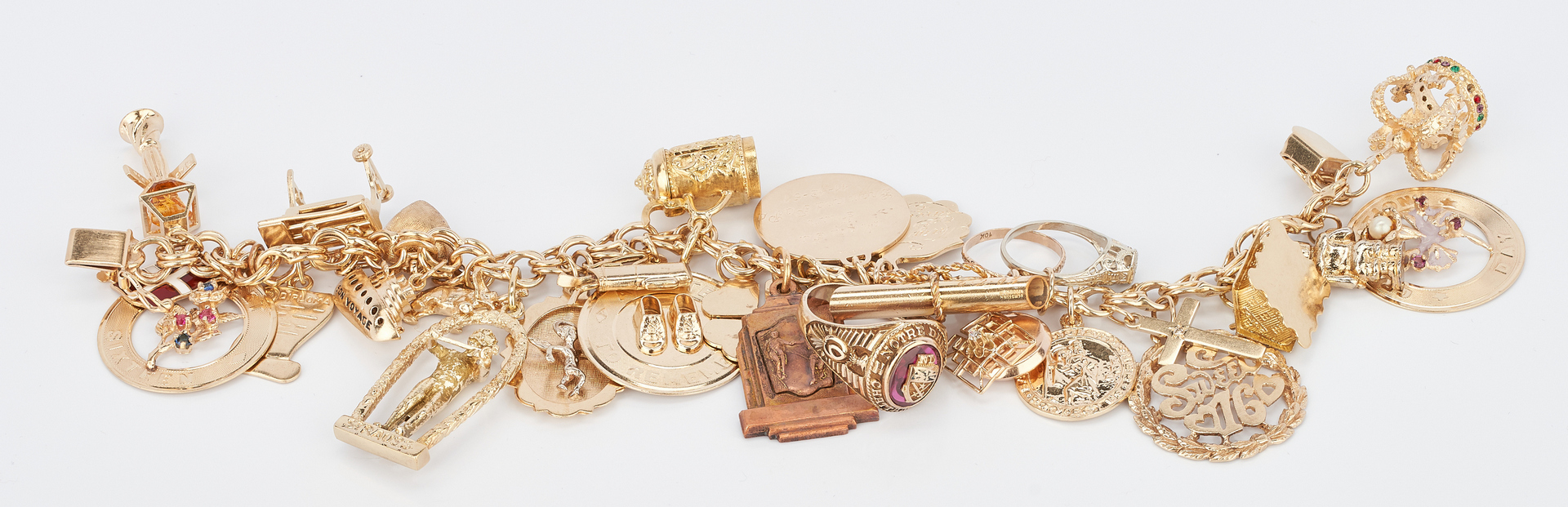 Lot 42: 14K Charm Bracelet with 30 Charms