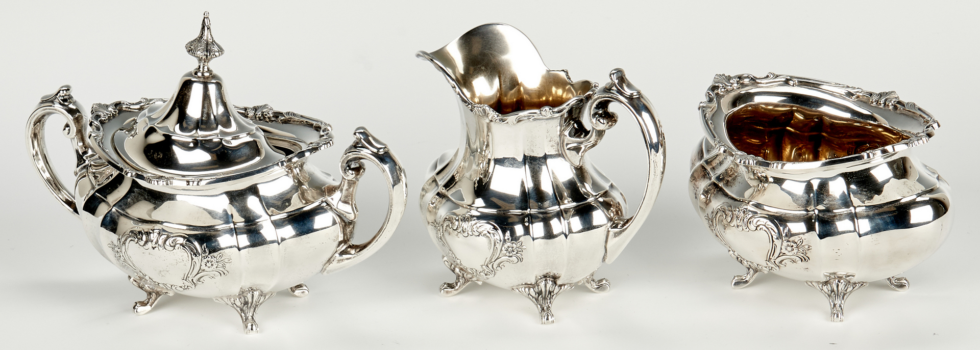 Lot 432: Reed & Barton Sterling Tea Set, Hampton Court Shield