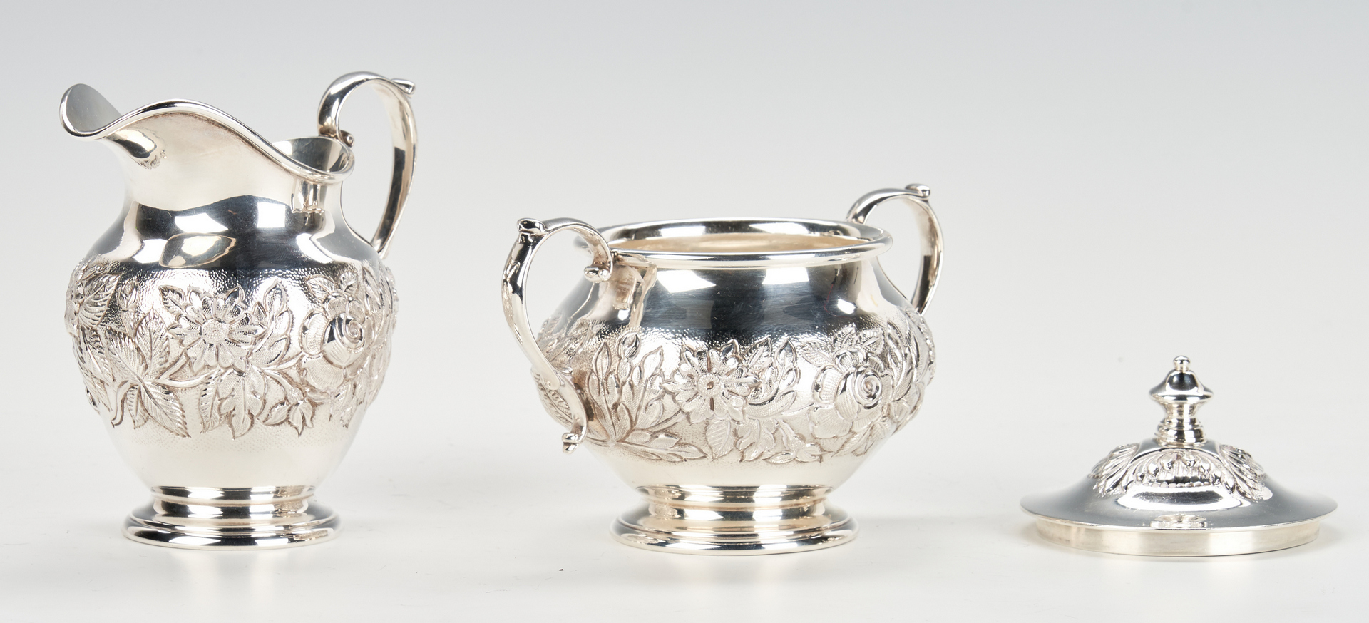Lot 436: Kirk Repousse Sterling Tea Set and Candelabra
