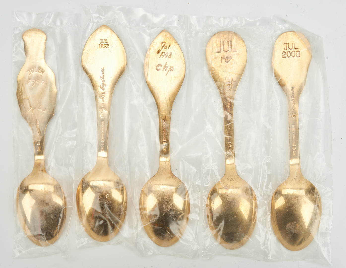 Lot 442: 25 A. Michelsen Gilded Sterling Silver Christmas Spoons, 1970-2000