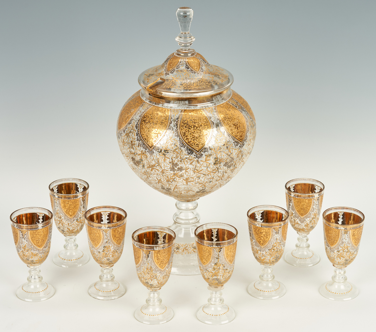 Lot 469: Glass 9-Piece Gilt & Silver Punch Set, attr. Moser