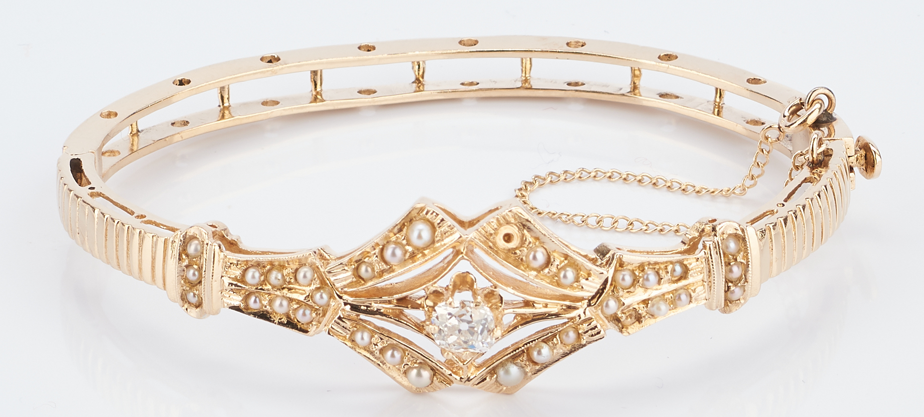 Lot 776: 14K Victorian Diamond & Pearl Bangle Bracelet