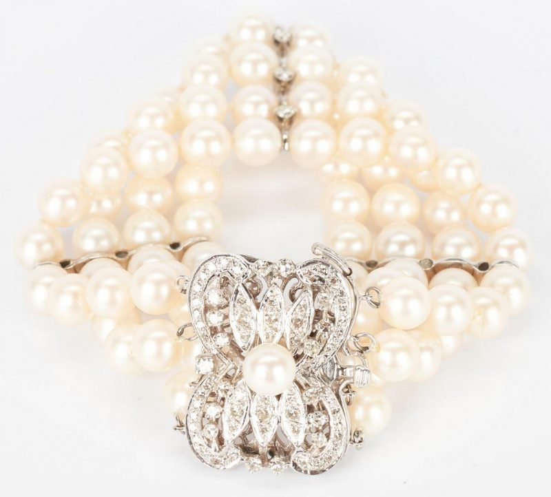 Lot 778: 14K Four Strand Pearl & Diamond Bracelet