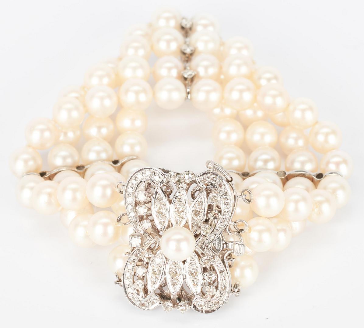 Lot 778: 14K Four Strand Pearl & Diamond Bracelet