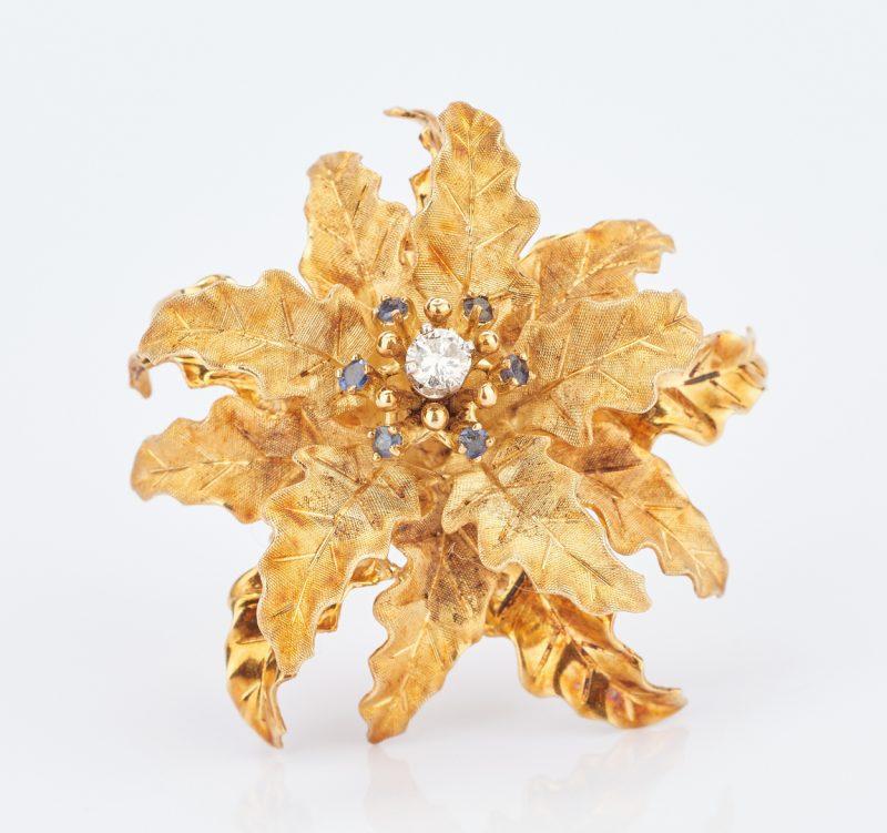 Lot 780: 18K Gold & Diamond Flower Brooch