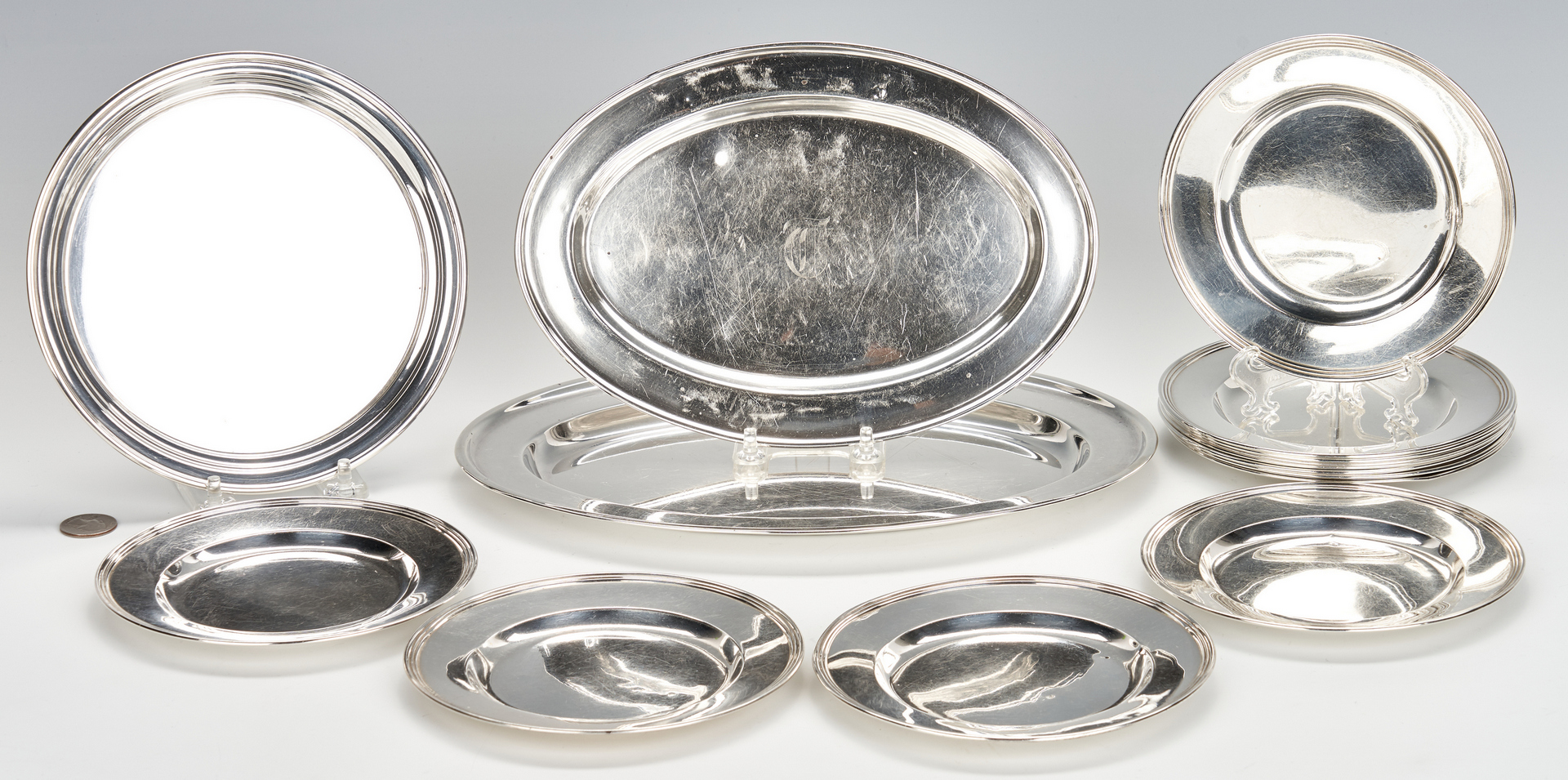 Lot 803: 12 Sterling Bread Plates and 3 Serving Trays