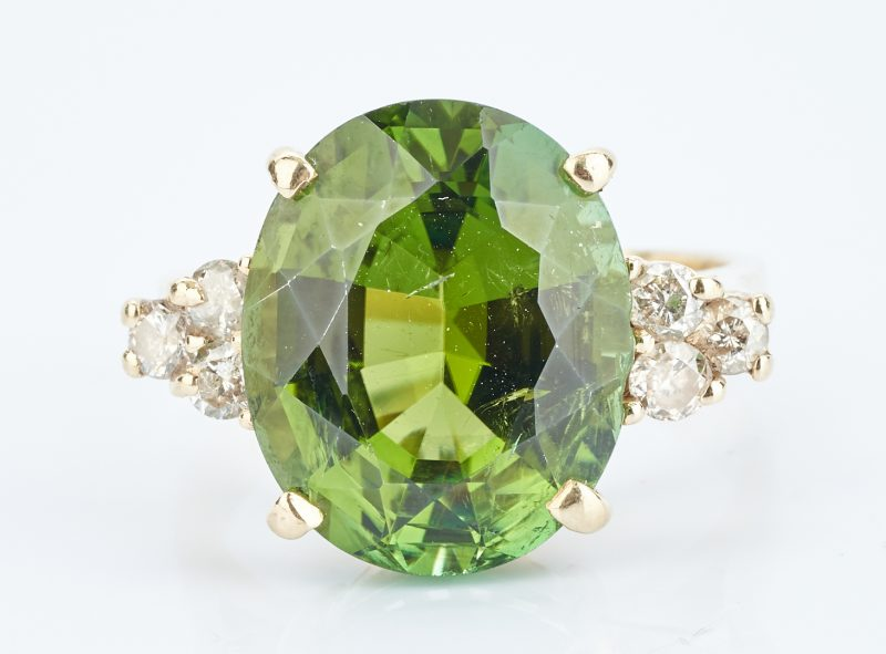 Lot 927: Peridot and Diamond 14K Ring