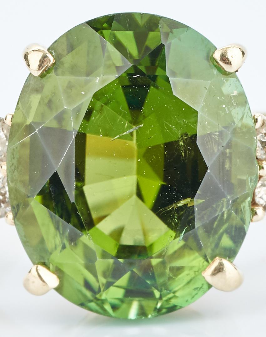 Lot 927: Peridot and Diamond 14K Ring