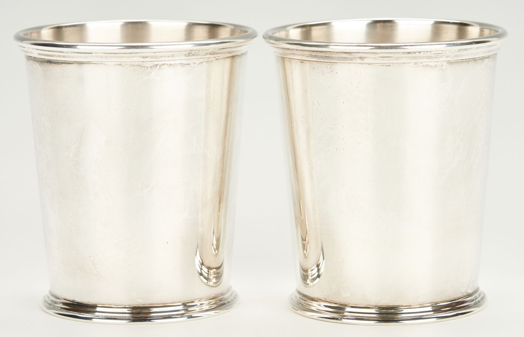 Lot 946: 7 Kirk & Son Sterling Julep Cups & 2 Match Boxes