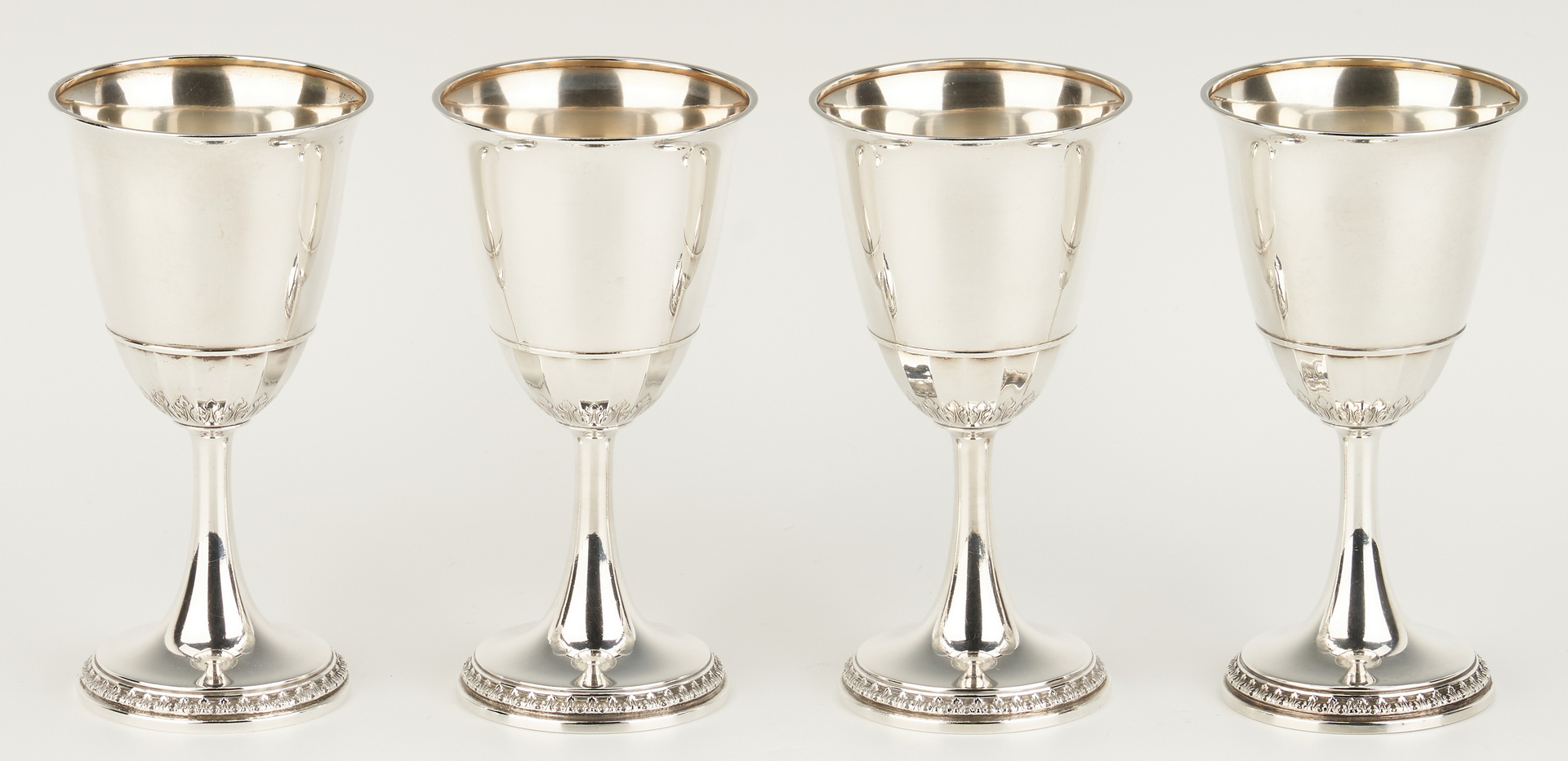 Lot 1046: 4 Sterling Silver Goblets and 2 tall beakers