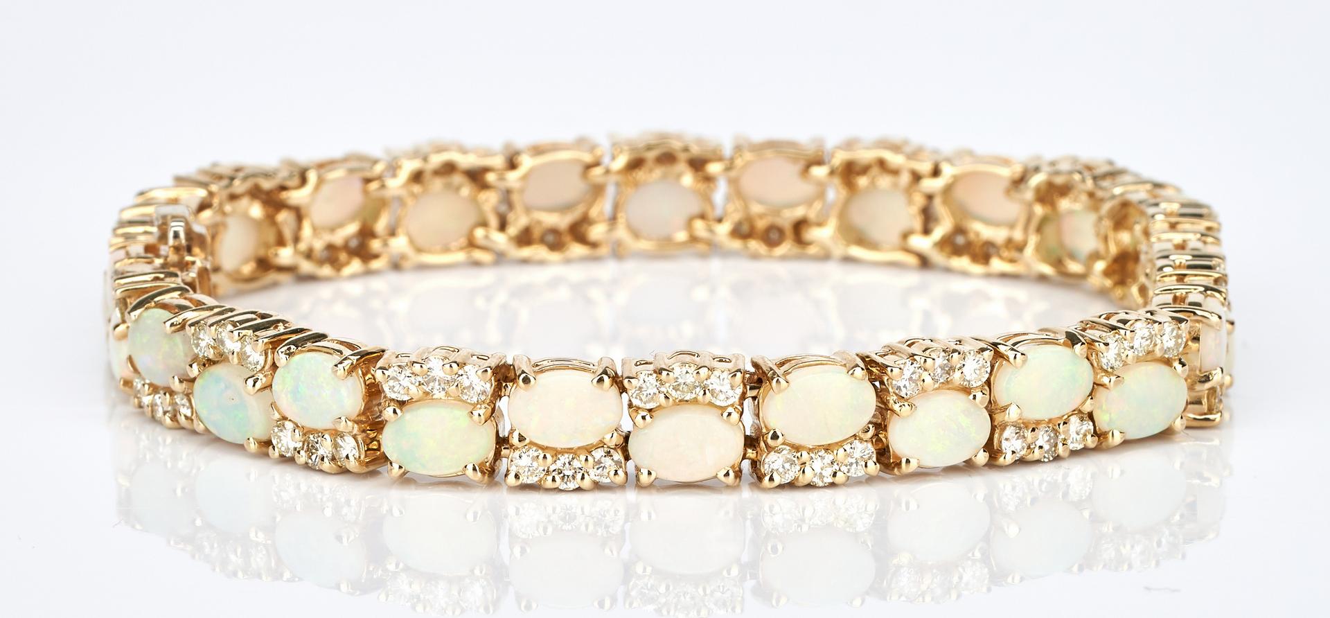 Lot 229: Ladies 14K Opal & Diamond Bracelet