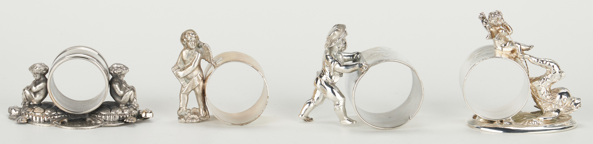 Lot 250: 13 Silverplated Napkin Rings incl. Figural Children