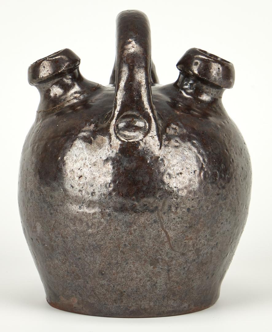 Lot 398: Southern Earthenware Monkey Jug, Dated 1866