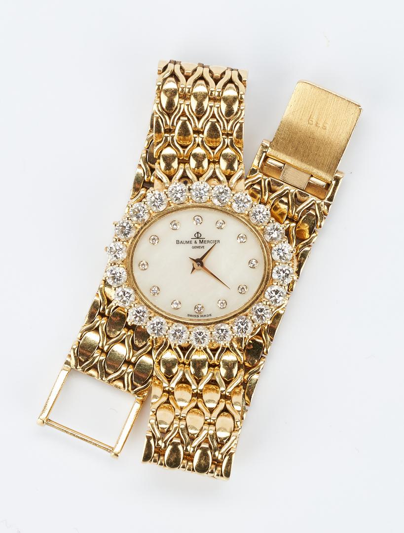 Lot 40: 18K Baume & Mercier watch with Diamond Surround