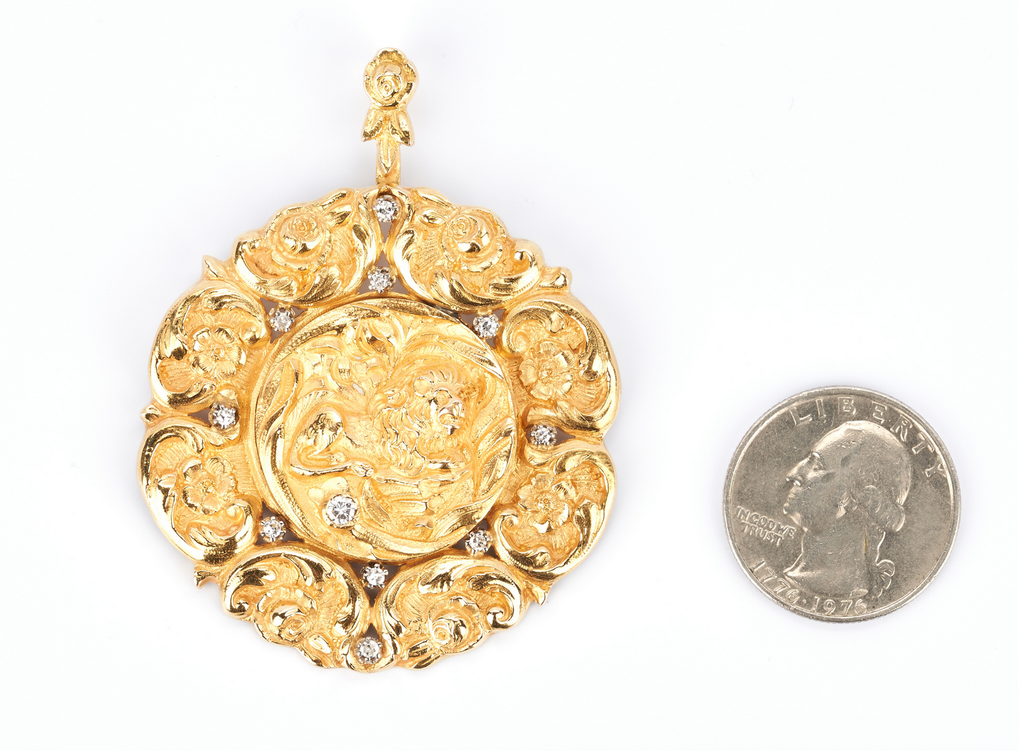 Lot 418: 22K Gold and Diamond Lion and Flower Pendant